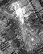 Aerial view of the Manzanar Airstrip, Inyo County, California, United States showing a portion of the Manzanar Relocation Center across the highway, 1 Oct 1944.