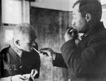 Soviet Major General Vladimir V. Kirpitsnikov, in captivity, lighting a cigarette for Finnish Lieutenant General Lennart Oesch, Russia, Sep 1941