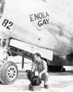 Thomas Ferebee, bombadier of B-29 Bomber Enola Gay, with Norden bombsight, Tinian, Mariana Islands, 6 Aug 1945