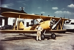 N3N-3 aircraft (Bureau Number 2885) in front of building 57, Naval Air Station Anacostia, Washington DC, United States, 1940; note JRF-4 Goose (Bureau Number 3852) in background
