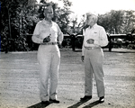 Army MGen Maxwell Murray and VAdm Aubrey Fitch at the Luganville Airfield at Espiritu Santo, New Hebrides awaiting first lady Eleanor Roosevelt on her tour of the South Pacific on behalf of the Red Cross, 14 Sep 1943.
