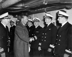 Secretary of the Navy Frank Knox greeting officers aboard the carrier USS Saratoga, circa 1943.