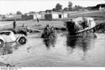 Raupenschlepper Ost tractor towing a 5 cm PaK 38 gun through water, Russia, Jun-Jul 1944