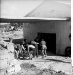 German troops pushing a 5 cm PaK 38 gun into a building, Italy, 1944, photo 2 of 2