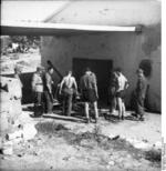 German troops pushing a 5 cm PaK 38 gun into a building, Italy, 1944, photo 1 of 2