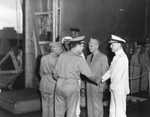 Flag officers aboard USS Enterprise being welcomed back to Pearl Harbor, Hawaii 5 Feb 1942 after the Marshalls-Gilberts Raids. VAdm William Halsey (center) with RAdm's Aubrey Fitch and Raymond Spruance at each end.