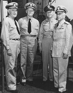 Rear Admiral David Bagley, Commander Hawaiian Sea Frontier; Admiral Chester Nimitz; Army Major General Delos Emmons, Military Governor of Hawaii; and Rear Admiral Aubrey Fitch aboard USS Saratoga, 16 Jun 1942.