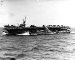 Escort carrier USS Attu the morning after riding out a punishing typhoon that scattered aircraft all over the flight deck and washed 3 aircraft overboard, 5 Jun 1945.
