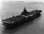 USS Ticonderoga off Hampton Roads, Virginia, United States, 26 Jun 1944. Two months later, the flight deck would be extended 11-feet to nearly cover the forward 40mm anti-aircraft mounts.