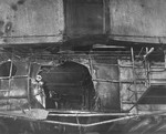 Damage to the Gallery Deck of the USS Ticonderoga as seen up and aft from the hanger deck. On 21 Jan 1945 a special attack plane crashed through the flight deck and through the gallery deck here. Feb 1945 photo.