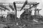 Merchant ships under construction, Howaldtswerke shipyard, Kiel, Germany, date unknown