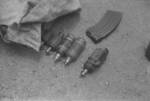 Captured Japanese Type 96 machine gun cartridge, Type 91 grenades, and unidentified grenade type, Hubei Province, China, 1942