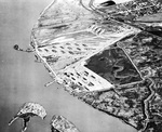 Aerial View of the ammunition loading facilities at Port Chicago, California, United States, Apr 1944. The curved pier at left is where the 17 Jul 1944 explosion took place.