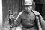 Chinese soldier displaying captured Japanese chemical weapon canister, Changde, Hunan Province, China, 17 Dec 1943