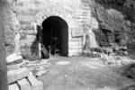Civilian sitting at the entrance of an air raid shelter, Chongqing, China, 14 Nov 1941