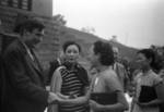 Wendell Wilkie, Song Meiling, and others at an event held in honor of special envoy Wendell Wilkie, Henan Province, China, 1942; note Kong Xiangxi (H. H. Kung) in background partially covered