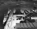Seven cruisers at Pearl Harbor, Hawaii, 2 Feb 1933. Clockwise from left are Augusta, Chicago, Salt Lake City, Louisville, Pensacola, unidentified destroyer, Fox, Kane (on marine railway), Northampton, and Chester.