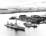 Cruiser USS Augusta entering Pearl Harbor, Hawaii passing the Ford Island seaplane hangars and minesweeper Avocet, 1933.