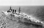 Trials Cruiser HMS Cumberland off Malta in pre-wetting experiments designed to keep radioactive fallout particles from adhering to a ship's surfaces, Sep 1955.