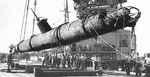 Japanese Type A Kō-hyōteki-class midget submarine used in the Pearl Harbor Attack recovered from the Keehi Lagoon off Honolulu, Hawaii, 6 Jul 1960. A floating heavy-lift crane is lowering the submarine onto a lighter.