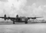 "C-87 Liberator (cargo variant of the B-24) at Borinquen Field, Puerto Rico, 1941 as part of the ""Arabian Knight"" route-mapping operation. Note the large flag marking used as neutrality markings in pre-war 1941."