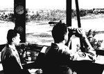 Controllers in the tower at Borinquen Field, Puerto Rico as a C-46 Commando lands on the runway, 1942.