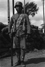 Chinese soldier in Shanghai, China, mid-1937; note Hangyang Type 88 rifle and German-made helmet and grenades