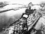 USS Tennessee at Pier 6 at the Puget Sound Naval Shipyard, Bremerton, Washington, United States, 19 Feb 1942. The photo was taken from the Hammerhead crane at the end of the pier (shadow).