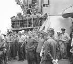 Japanese liaison party aboard destroyer USS Cummings as part of the occupation process at Higashi Harbor, Haha Jima, Bonin Islands, 14 Sep 1945.