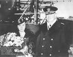 Growler sponsor Mrs. Lucile L. Ghormley, wife of Vice-Admiral Robert L. Ghormley, and Rear Admiral Charles A. Dunn at the christening and launching of the submarine Growler, Groton, Connecticut, 22 Nov 1941.