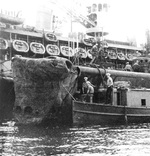 Inspection of USS Growler's damaged bow while nested alongside sub-tender USS Fulton at Capricorn Wharf, New Farm Submarine Base, Brisbane, Queensland, Australia, 17 Feb 1943.
