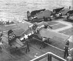 Eastern Aircraft FM2 Wildcats of Composite Squadron VC-93 on the flight deck of escort carrier USS Petrof Bay off Okinawa, 25 Mar 1945.