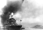 Battleship USS Maryland in Berth F5, Pearl Harbor, Hawaii, 7 Dec 1941. Note capsized USS Oklahoma at right, USS Tennessee behind Maryland, and smoke from burning USS Arizona in the background.