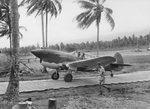 "RAAF Squadron Leader Keith W ""Bluey"" Truscott taxiing his P-40E Kittyhawk along the Marston Mats at Milne Bay Fighter Strip #3, Milne Bay, New Guinea, Sep 1942."