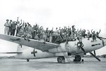 Celebratory photo of American servicemen on top of a Japanese G4M bomber painted in surrender markings at Ie Jima, 20 Aug 1945. This plane brought in Japanese envoys the day before and would take them out later this day