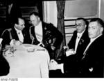 Ernst Udet, Erhard Milch, and Ernst Heinkel, and an unidentified man at a Lilienthal Society event at the Neuen Palais in Potsdam, Germany, 11 Oct 1938