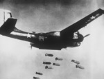 B-26C Invader aircraft of 3rd Bomb Wing of the US 5th Air Force dropping bombs over northern Korea, 1953