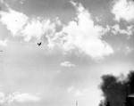 A damaged Zero fighter left a trail of smoke above Pearl Harbor, US Territory of Hawaii, 7 Dec 1941