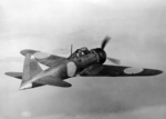 Rear quarter view of a captured A6M5 Zero fighter in flight, 25 Sep 1944