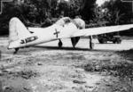 Captured Japanese A6M Zero fighter at Bougainville, Solomon Islands, Sep 1945; note missing stabilizer on aircraft and jeep in background