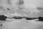US Army assault landing training at Bellows Field (Waimanalo Beach), Oahu, US Territory of Hawaii, 1945; note P-39 Airacobra aircraft, CCKW trucks, and Wailea Point in background