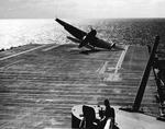 US Navy pilot Lt (jg) C. Clifton Francom unsuccessfully testing TBM Avenger torpedo bomber with experimental wing mounted radome aboard Ticonderoga, 4 Jul 1944, photo 1 of 5