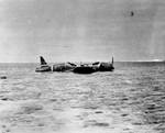 B5N2 torpedo bomber wreckage sitting atop Indispensable Reef as it was found on 9 Jun 1942; she was lost during the Battle of Coral Sea