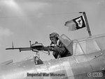 A British sergeant air-gunner manned his Vickers K gun from the rear cockpit of a Fairey Battle, May 1940; note the unofficial squadron pennant flying from the radio mast