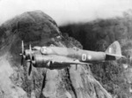 Beaufighter aircraft of No. 30 Squadron RAAF in flight over the Owen Stanley range, New Guinea, late 1942; the pilot was R. J. Brazenor with observer F. B. Anderson