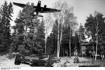 German Ju 52 aircraft flying over the crash site of a German Bf 110 fighter, near Oslo and Fornebu, Norway, 1940