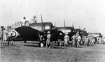 Buffalo Mark I fighters of Nos. 21 and 453 Squadrons RAAF being inspected by RAF personnel, Sembawang airfield, Singapore, 12 Oct 1941