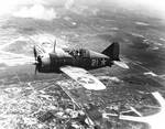 Lieutenant Commander Joseph C. Clifton in flight in a Buffalo fighter, 2 Aug 1942, photo 2 of 2