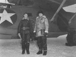US Navy Lieutenant William Thies (pilot, VP-41) and Captain Leslie Gehres (Commander, Fleet Air Wing 4) standing in front of Thies
