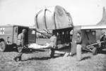USAAF Troop Carrier Command demonstrating loading a wounded man onto a CG-4A glider, Roosevelt Field, Long Island, New York, United States, 24 Mar 1945; note Dodge WC54 ambulance
